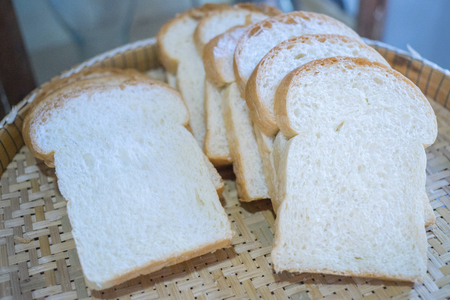 Sliced bread to toast in the basket