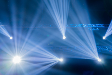 Stage Spotlight with Laser rays, light show at the Concert