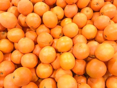 heap of fresh mandarin oranges texture background