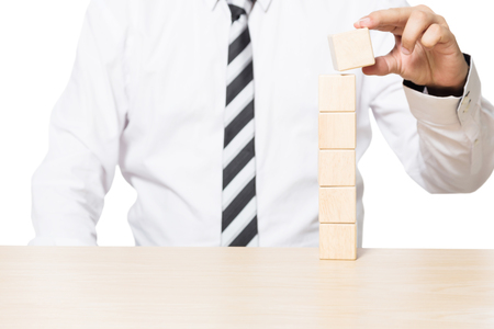 Close up Hand of a Businessman Arranging Wooden Blocks, Business concept for growth success process 写真素材