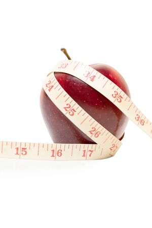 Diet Concept with fresh apple and measuring tape, isolated on white background 写真素材