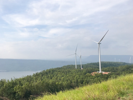 Group of Wind turbines generating electricity with blue sky, Energy Production with clean and Renewable Energy, energy conservation concept