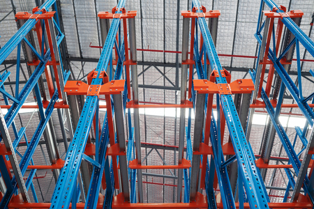 Warehouse storage interior with colorful steel shelves, pallet rack System
