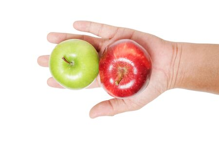 Hand holding a ripe green and red apple on outstretched hand isolated on white