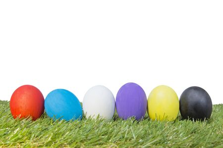 Colorful handmade easter eggs on green grass isolated on a white Background Reklamní fotografie
