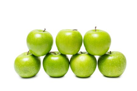 many green apples stacked isolated on white background