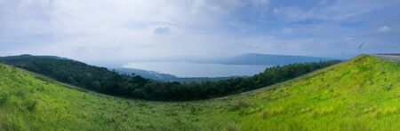 Beautiful panoramic view over lake and mountains background