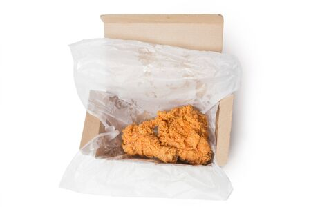 Close up Calf and chest fried chicken in box isolated on white