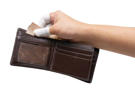 Hand in a fingertip glove holds money in a wallet, protecting itself from an epidemic.