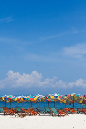 umbrellas and beach chair on a beautiful beach  in sunlight Stock Photo
