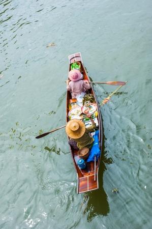 ferrying: Merchant at Ampawa Floating market, Thailand