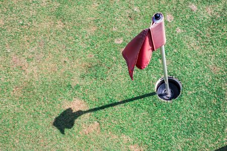 golf hole with flag  Stock Photo