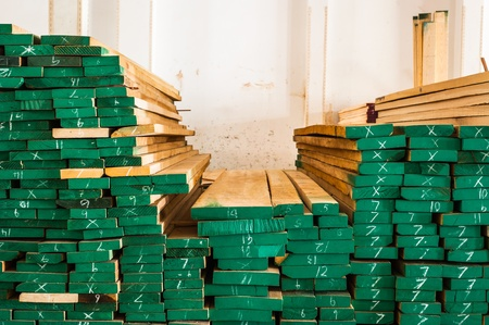 Pile of Wood Stored in stock painted green and marked size photo