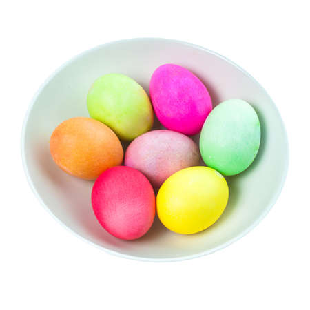 Colored eggs in bowl photo