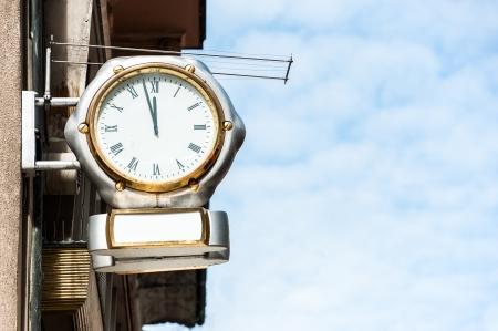 Silver clock sign of clock shop Stock Photo - 21050681