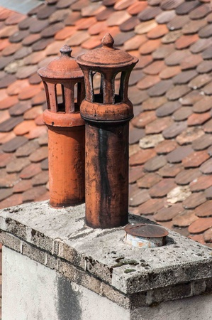 Morning with chimney on roof of houses Stock Photo - 21050690
