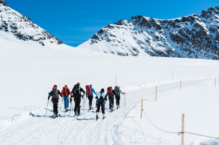 country boy: Group of Ski player walking on the snow into the mountain Stock Photo
