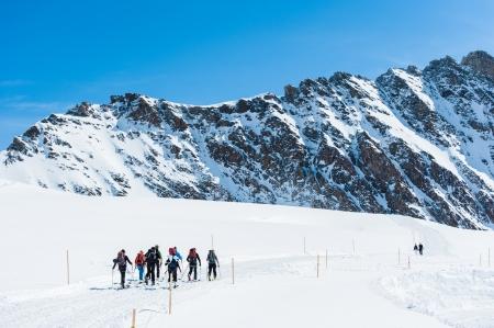 ski walking: Group of Ski player walking on the snow into the mountain Stock Photo