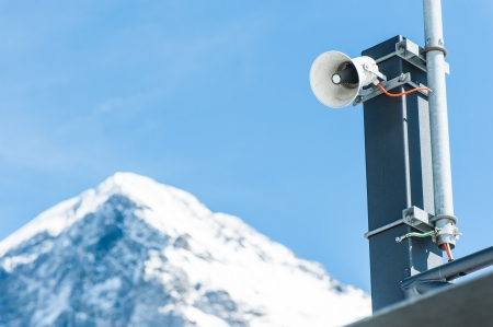 loud: Speaker with snow mountain in background