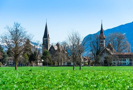 interlaken: Beautiful scene of town with green field and trees at Interlaken Stock Photo
