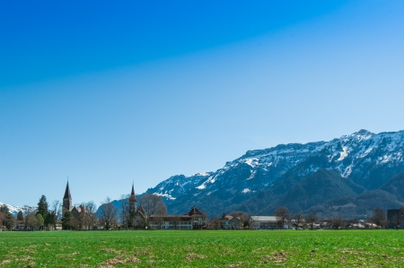 Beautiful scene of town with green field and trees at Interlaken Stock Photo