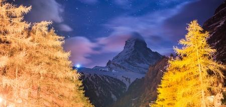 zermatt: Night Scene Matterhorn with golden pine Stock Photo
