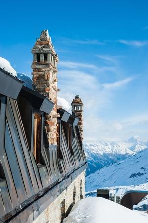 flue season: Chimny of Building on Snow Mountain