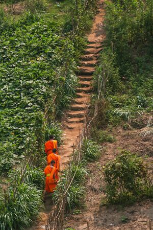buddhist monk: Three monks walking on the way of country side Stock Photo