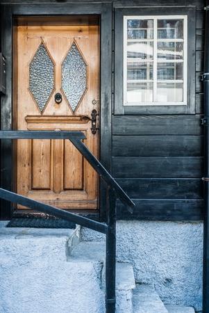 Door and Window on Black Wooden Wall