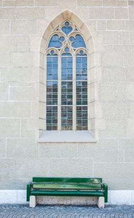 window of church with chair photo