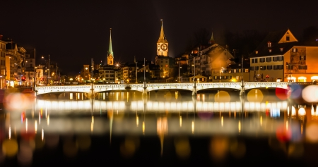 Night cityscape of Zurich, Switzerland with blurring effect and reflection