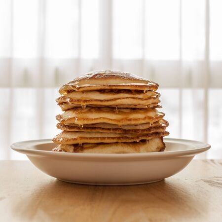 Pancakes on Dish with Honey photo