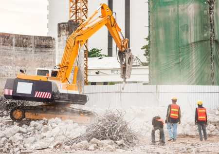 Worker and Excavator in construction site Stock Photo