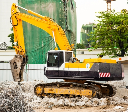 Excavator in construction site photo