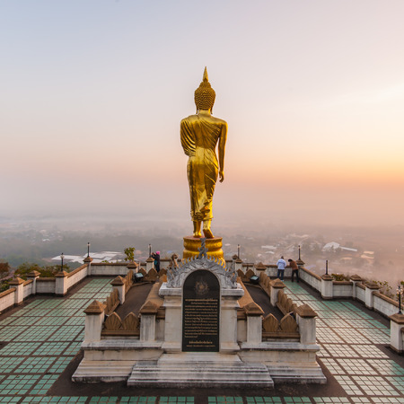 Golden Buddha statue in Wat Phra That Khao Noi, Nan Province, Thailand Stock Photo