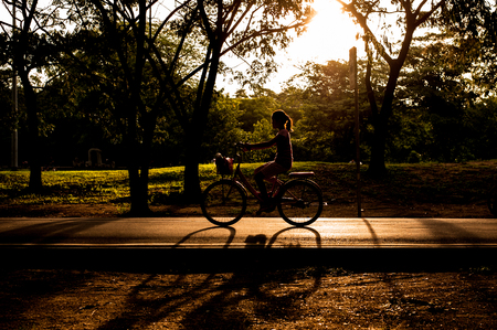 Girl riding bicycle in park photo