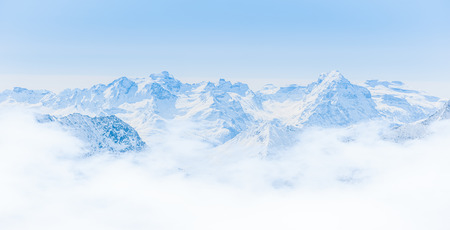 Snow Mountain Range Landscape with Blue Sky from Jungfrau Region photo
