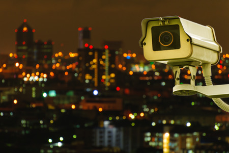 private security: CCTV with Bluring City  Stock Photo