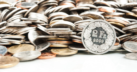 swiss franc: Swiss Franc Coin with Pile of Coin