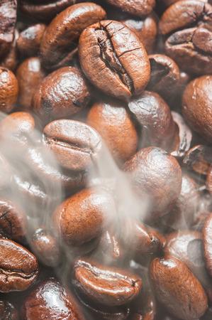 jamoke: Roasted Coffee bean with smoke on surface