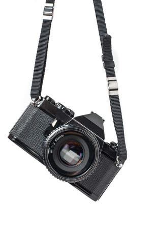 dslr camera: Old SLR Black Camera on White