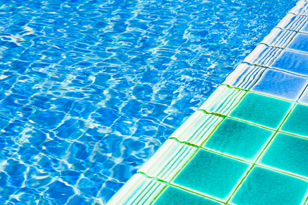 Texture of swimming pool floor trough water