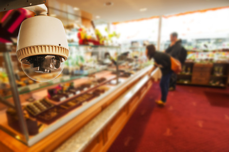 big brother spy: CCTV Camera or surveillance Operating in shop Stock Photo