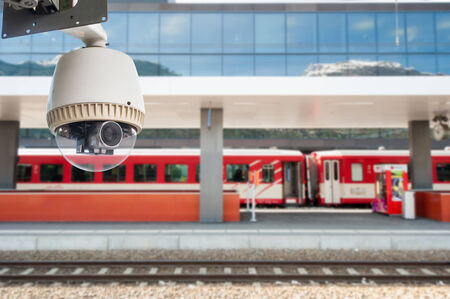 CCTV Camera or surveillance Operating on train station platform photo