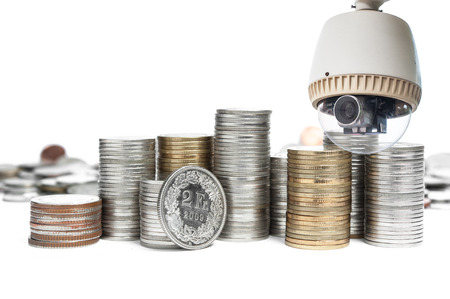margin of safety: Coin with CCTV Camera operating on white  Stock Photo