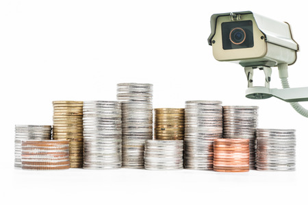bank records: Pile of Coin with CCTV Camera operating on white background
