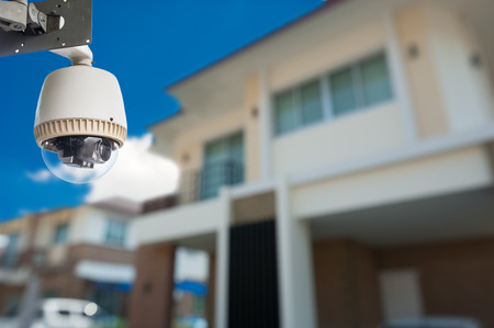 CCTV Camera with house  Stock Photo - 27108094