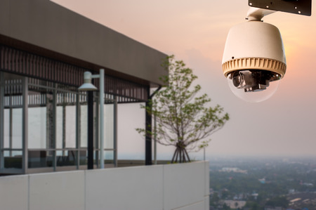 cctv camera: CCTV Camera or surveillance Operating on balcony of building Stock Photo