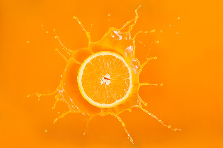 splash orange juice Stok Fotoğraf