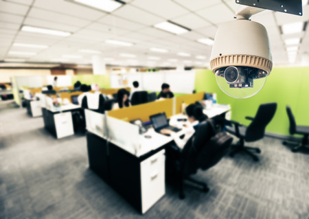 security monitor: CCTV Camera or surveillance Operating in office building Editorial